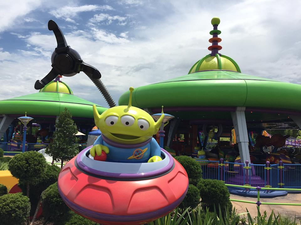 Alien Swirling Saucers spins guests through Andy's backyard at Toy Story Land in Disney's Hollywood Studios.