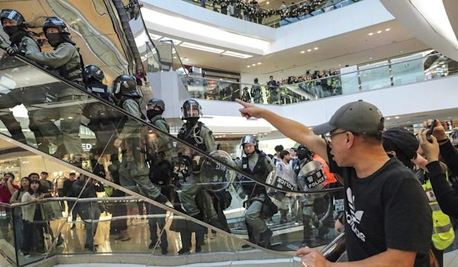 Riot police inside the Festival Walk shopping centre in Kowloon Tong. Photo: Edmond So