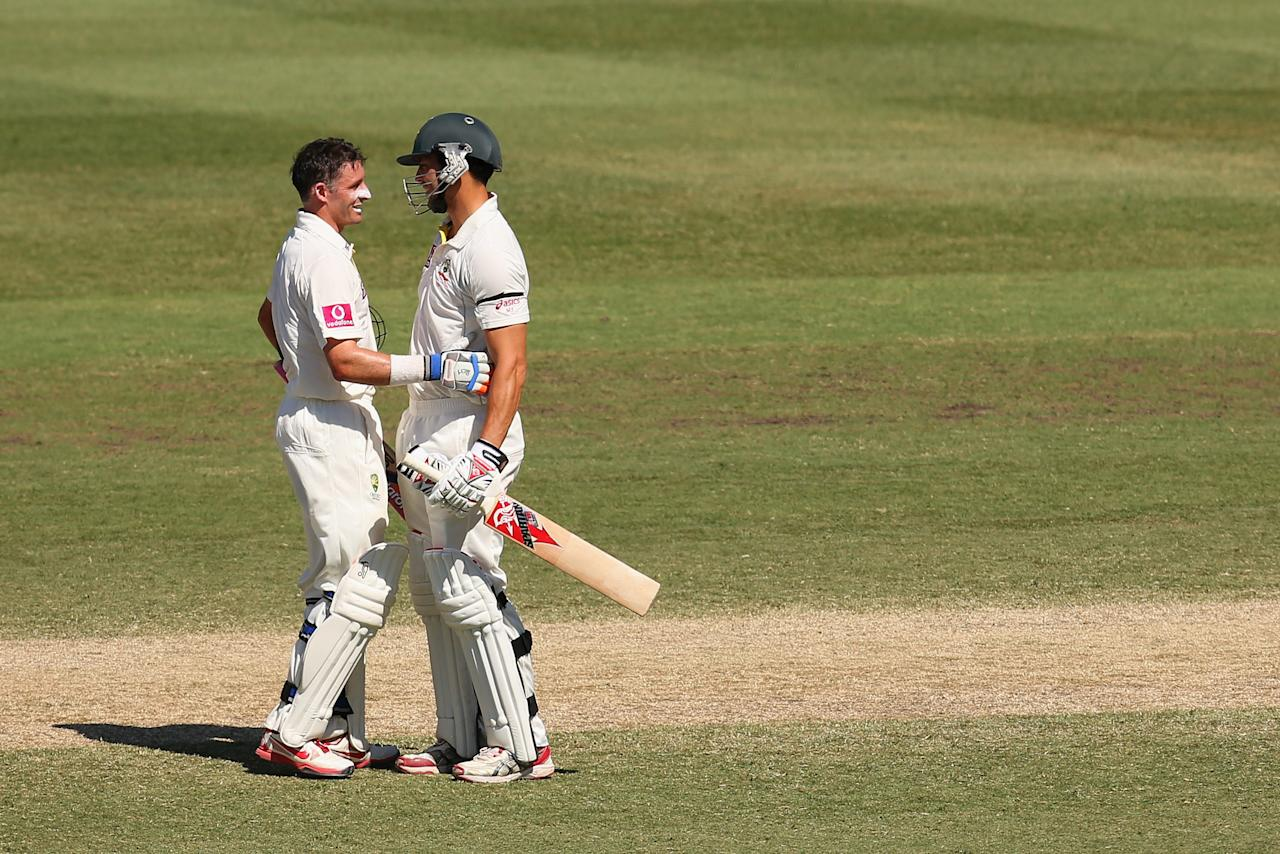 SYDNEY, AUSTRALIA - JANUARY 06: Michael Hussey of Australia embraces team mate Mitchell Johnson after winning the test during day four of the Third Test match between Australia and Sri Lanka at Sydney Cricket Ground on January 6, 2013 in Sydney, Australia.  (Photo by Cameron Spencer/Getty Images)