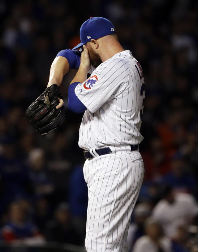 Chicago Cubs starting pitcher Jon Lester wipes his face after Colorado Rockies' DJ LeMahieu hit a ground-rule double during the first inning of the National League wild-card playoff baseball game Tuesday, Oct. 2, 2018, in Chicago. (AP Photo/Nam Y. Huh)