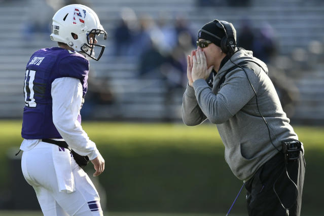 Northwestern head coach Pat Fitzgerald, right, yells to quarterback Aidan Smith (11) during the second half of an NCAA college football game against Purdue, Saturday, Nov. 9, 2019, in Evanston, Ill. Purdue won 24-22. (AP Photo/Paul Beaty)