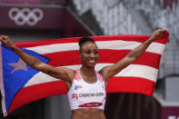 Jasmine Camacho-Quinn, of Puerto Rico, wins the wins a women's 100-meter hurdles final at the 2020 Summer Olympics, Monday, Aug. 2, 2021, in Tokyo. (AP Photo/Matthias Schrader)