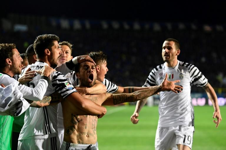 Juventus' defender Daniel Alvez da Silva celebrates with teammates after scoring during the Italian Serie A football match against Atalanta on April 28, 2017