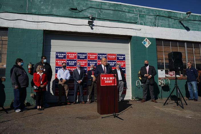 Rudy Giuliani, personal attorney for President Trump, speaks at a news conference in the parking lot of the Four Seasons Total Landscaping company on November 7, 2020 in Philadelphia. / Credit: BRYAN R. SMITH/AFP via Getty Images