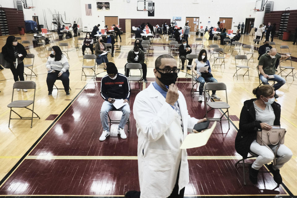 Medical staff watch and advise walk-in patients who received their COVID-19 vaccination at a pop-up clinic at Western International High School on April 12, 2021 in Detroit, Michigan. (Matthew Hatcher/Getty Images)