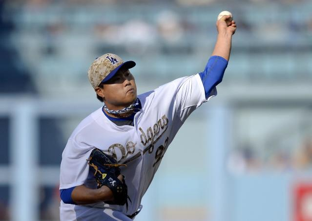 Los Angeles Dodgers' Hyun-Jin Ryu pitches in the first inning of a baseball game against the Cincinnati Reds, Monday, May 26, 2014, in Los Angeles. (AP Photo/Gus Ruelas)