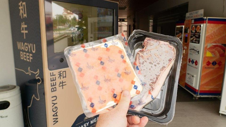 Wagyu beef vending machine and Norwegian Salmon ATM with dispensed products.