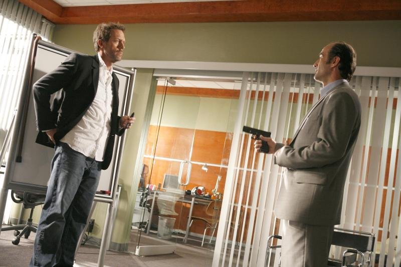 """In this image released by Fox, Hugh Laurie, left, and Elias Koteas, are shown in a scene from the second season finale of """"House, M.D."""" The Fox medical drama concludes its eight-season run on Monday, May 21, 2012, with a finale at 9 p.m. EDT, preceded by a one-hour retrospective. (AP Photo/Fox, Isabella Vosmikova)"""