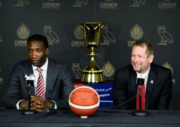 Canada Basketball general manager Rowan Barrett, left, and head coach Nick Nurse, right, look to pick their 12 best players for an upcoming last-chance Olympic qualifier during training camp in Tampa. (Nathan Denette/The Canadian Press - image credit)
