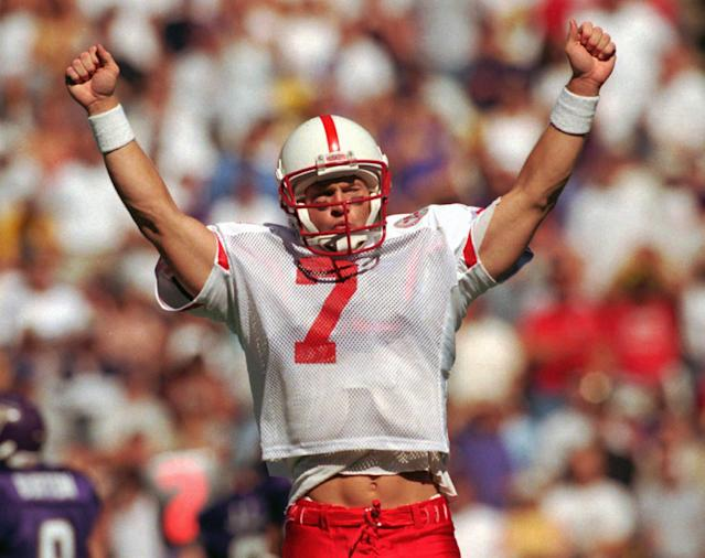 FILE – In this Sept. 20, 1997, file photo, Nebraska quarterback Scott Frost turns to Huskers' fans to signal his team's third first-half touchdown against Washington. (AP Photo/Elaine Thompson, File)