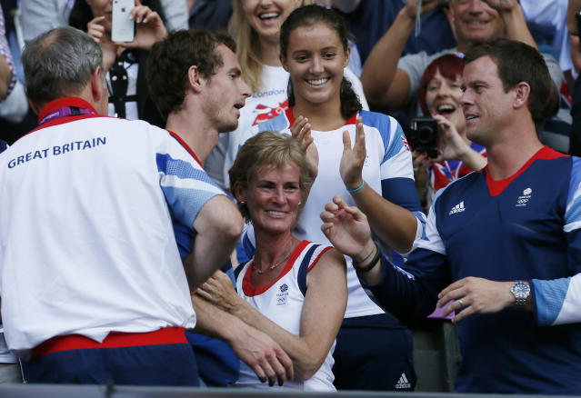 Britain's Andy Murray (2nd from L) greets friends and family, including his mother Judy (C), after defeating Switzerland's Roger Federer in the men's singles tennis gold medal match at the All England Lawn Tennis Club during the London 2012 Olympic Games August 5, 2012. REUTERS/Stefan Wermuth (BRITAIN - Tags: OLYMPICS SPORT TENNIS)