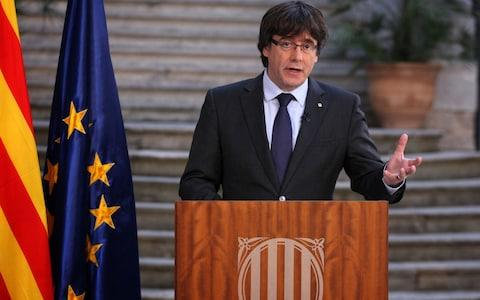 Catalan President Carles Puigdemont speaks during a statement at the Palau Generalitat today - Credit: Presidency Press Service, Pool Photo via AP