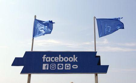 The logo of the social network Facebook is seen on a beach during the Cannes Lions Festival in Cannes, France, June 21, 2017.                 REUTERS/Eric Gaillard