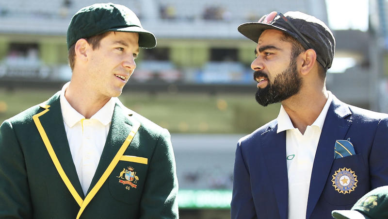 Tim Paine and Virat Kohli talk before the coin toss.