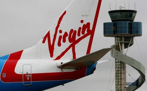 Etihad Airways said it won approval from Australia to boost its stake in Virgin Australia to up to 10 percent