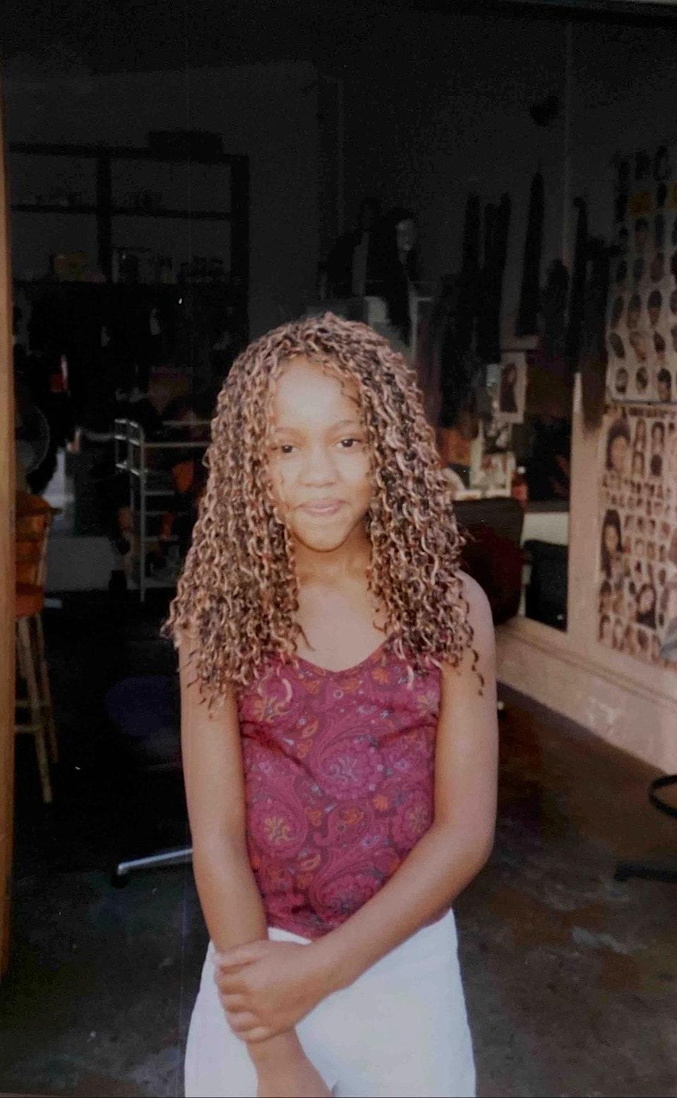 """""""I was obsessed with these noodle braids growing up,"""" says Heim. """"Me at my mom's salon in the '90s."""""""