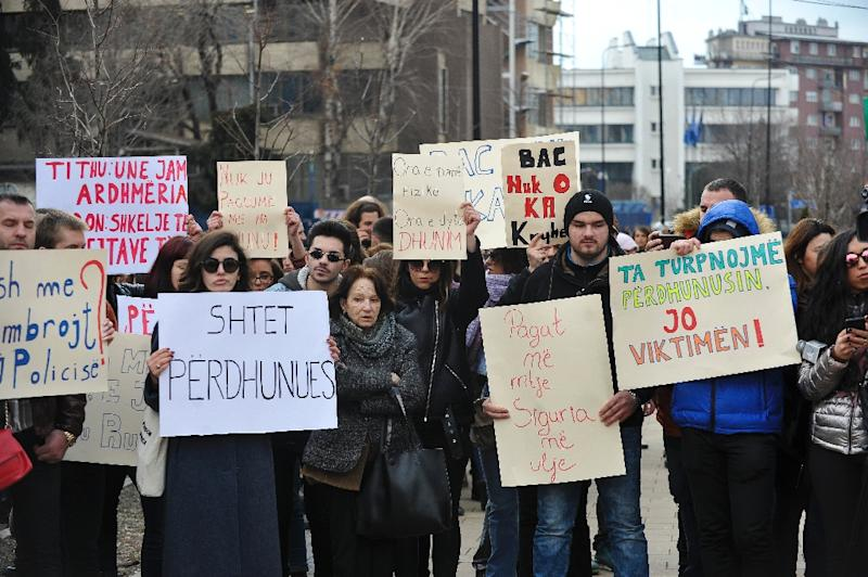 """""""Shame"""" chanted the protesters, waving signs with slogans like """"Danger, paedophile zone"""" (AFP Photo/STR)"""