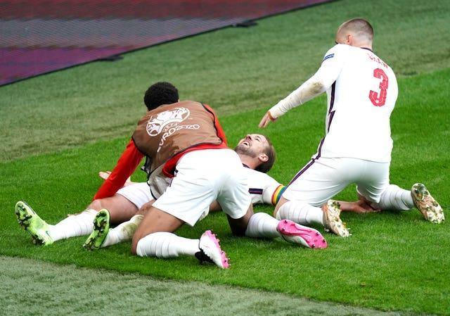 Kane (centre) was also on target in a memorable last-16 victory over Germany