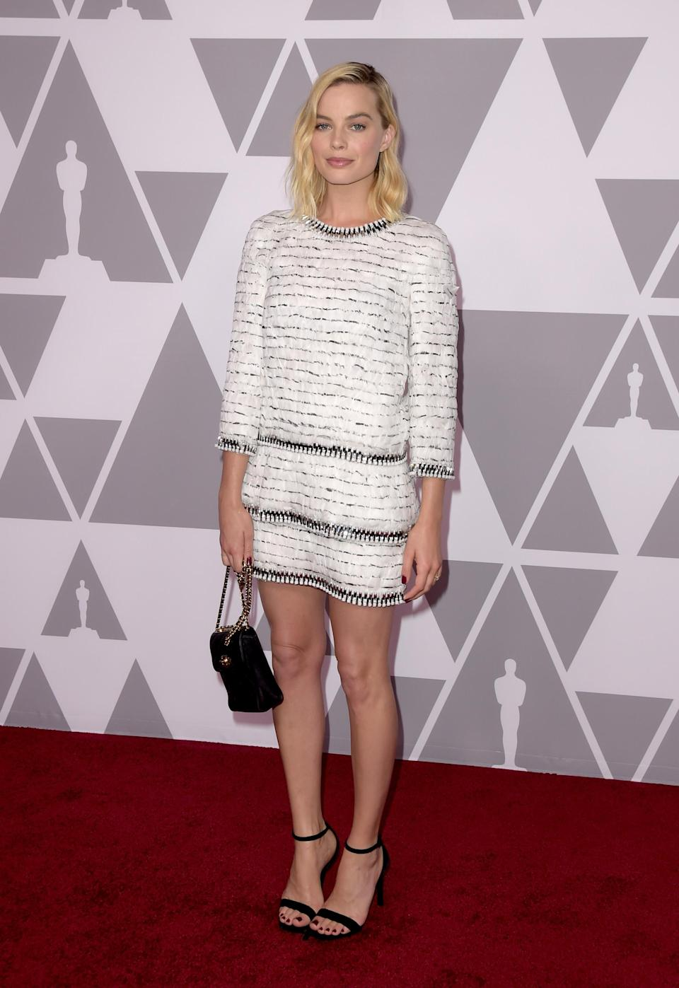 <p>Margot wore an all-Chanel look to the lunch – the exact outfit that Cindy Crawford's daughter Kaia Gerber modelled on the catwalk in Paris earlier this year.<em> [Photo: Getty]</em> </p>