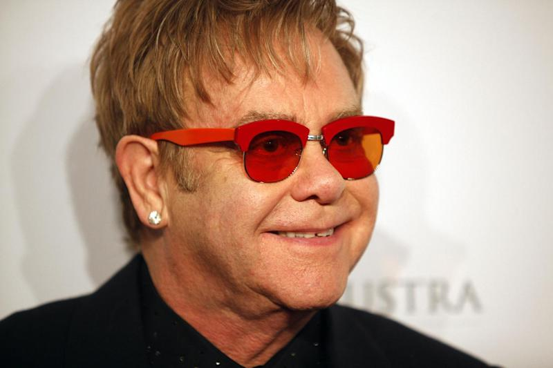 "FILE - In this Oct. 15, 2013 file photo, Elton John arrives at the Elton John AIDS Foundation's 12th Annual ""An Enduring Vision"" benefit gala at Cipriani Wall Street in New York. Tom Hardy will play John in a biopic titled ""Rocketman."" Focus Features announced Hardy's casting as the iconic piano man on Wednesday, Oct. 23, 2013. (Photo by Carlo Allegri/Invision/AP, File)"