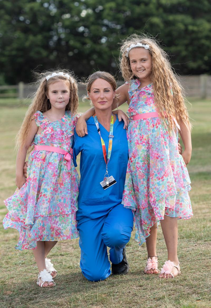 Nurse Suzie Vaughan with her daughters Hettie and Bella before a visit by the Duke and Duchess of Cambridge to Queen Elizabeth Hospital in King's Lynn as part of the NHS birthday celebrations.