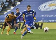 Leicester's Jamie Vardy scores his side's opening goal during the English Premier League soccer match between Leicester City and Wolverhampton Wanderers at the King Power Stadium in Leicester, England, Sunday, Nov. 8, 2020. (AP Photo/Rui Vieira, Pool)