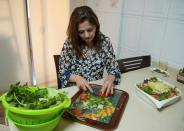 Hala Sheikh prepares Fattoush, a popular salad, at her house in Beirut