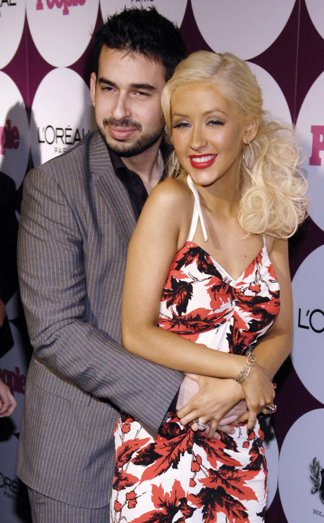 Singer Aguilera and her husband Bratman pose together at a post-Grammy Awards party hosted by Beyonce and People magazine.