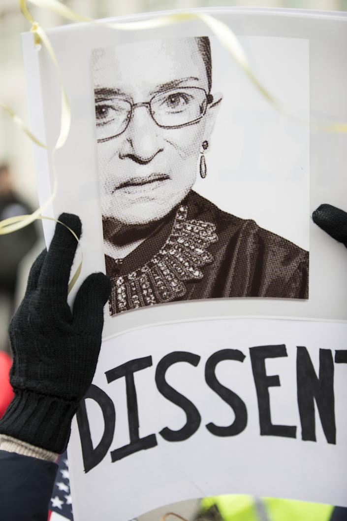 A protest sign with a picture of Ruth Bader Ginsburg