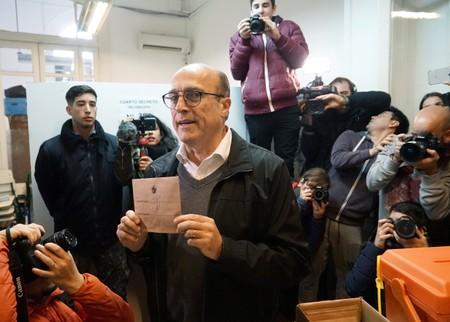 Former mayor of Montevideo Daniel Martinez of the Frente Amplio party poses for photographers before casting his vote during primary elections ahead of the presidential elections later this year, in Montevideo