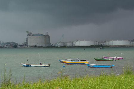 FILE PHOTO: Boats float in front of the VOPAK oil storage terminal in Johor, Malaysia November 7, 2017.   REUTERS/Henning Gloystein/File Photo/File Photo/File Photo