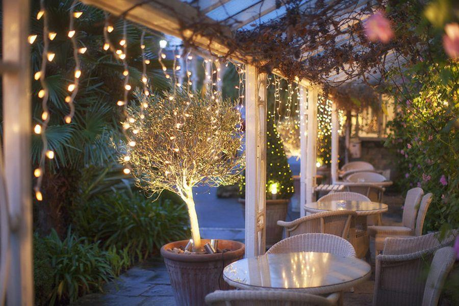 """<p>Make it an island escape by heading to the Isle of Wight for a Christmas to remember at <a href=""""https://www.booking.com/hotel/gb/the-royal-ventnor.en-gb.html?aid=2070929&label=christmas-hotels"""" rel=""""nofollow noopener"""" target=""""_blank"""" data-ylk=""""slk:The Royal Hotel"""" class=""""link rapid-noclick-resp"""">The Royal Hotel</a> in Ventnor. Originally built as a coaching house in 1832, the main hotel is nestled into exotic south facing gardens overlooking Ventnor's stunning coastline. The historic building has entertained the crowned heads of Europe, and was a favourite destination of Queen Victoria's whenever she visited Ventnor. Over Christmas, you can expect performances from local carol singers, a traditional Christmas lunch and mulled wine and mince pies.</p><p><a class=""""link rapid-noclick-resp"""" href=""""https://www.booking.com/hotel/gb/the-royal-ventnor.en-gb.html?aid=2070929&label=christmas-hotels"""" rel=""""nofollow noopener"""" target=""""_blank"""" data-ylk=""""slk:CHECK AVAILABILITY"""">CHECK AVAILABILITY</a></p>"""