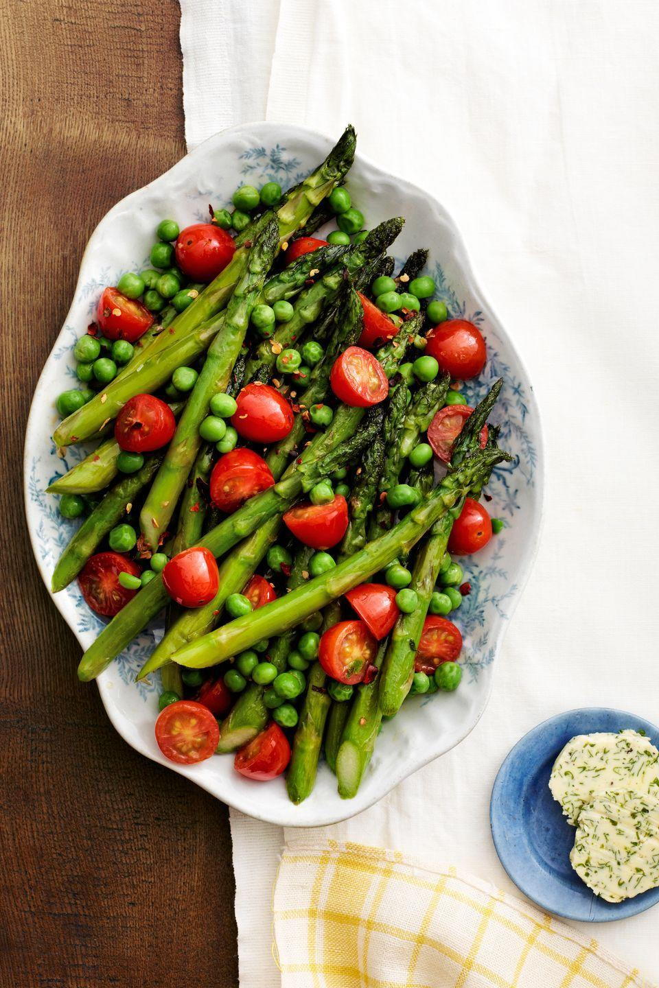 "<p>These garden-fresh vegetables are full of flavor. Sauteed lightly in olive oil and garlic then served with homemade herb butter, they're the perfect addition to any meal.</p><p><strong><a href=""https://www.countryliving.com/recipefinder/asparagus-peas-tomatoes-herb-butter-recipe-clx0414"" rel=""nofollow noopener"" target=""_blank"" data-ylk=""slk:Get the recipe"" class=""link rapid-noclick-resp"">Get the recipe</a>.</strong></p>"