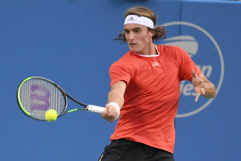 Tsitsipas, Isner move on at Citi Open — ATP roundup