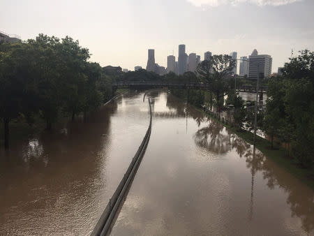 Flood waters cover Memorial Drive along Buffalo Bayou in Houston, Texas May 26, 2015 in a photo provided by the Harris County Flood Control District. REUTERS/Harris County Flood Control District/handout via Reuters