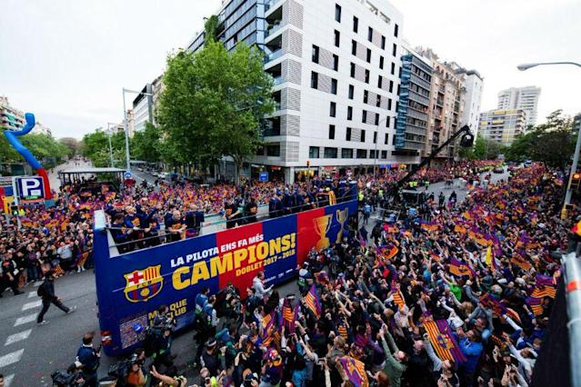 Barcelona players and coaches showed off the Spanish league and Copa del Rey trophies to the city and themselves in selfies in a victory parade on Monday.
