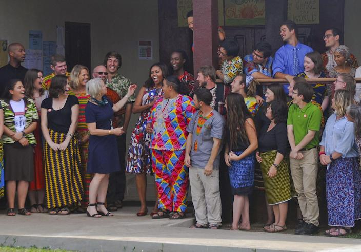 <p>U.S. first lady Michelle Obama laughs with Peace Corps members at a project 70 kilometers (43 miles) from the capital city Monrovia in Kakata, Liberia, Monday, June 27, 2016. (AP Photo/Abbas Dulleh) </p>