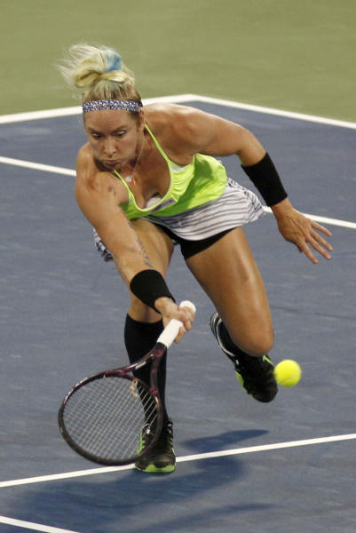 Bethanie Mattek-Sands, from the United States, retuns a shot from Roberta Vinci, from Italy, during a match at the Western & Southern Open tennis tournament on Monday, Aug.12, 2013, in Mason, Ohio. (AP Photo/David Kohl)