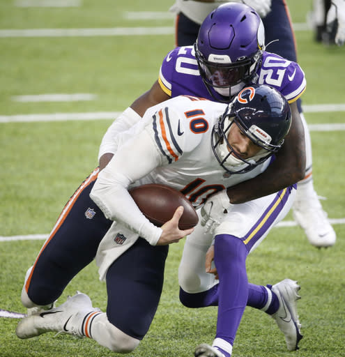Chicago Bears quarterback Mitchell Trubisky (10 is tackled by Minnesota Vikings cornerback Jeff Gladney (20) during the second half of an NFL football game, Sunday, Dec. 20, 2020, in Minneapolis. (AP Photo/Bruce Kluckhohn)