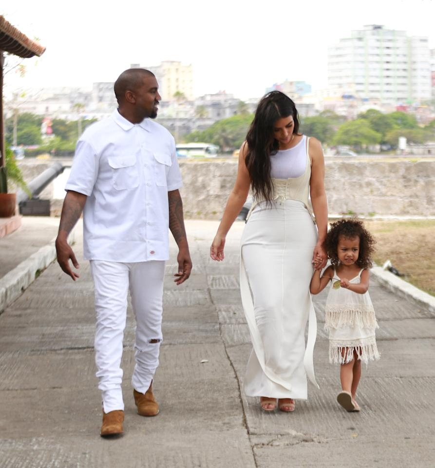 <p>Cuba is so hot right now, and the Kardashian-West clan just affirmed it. While in Havana, Kanye, Kim and North — sans Saint — stepped out for a stroll, in coordinated variations of white. While Yeezy opted for the crispest shade, Kim and Nori donned cream-colored dresses. North, who gave up her tried and true top knot for loose curls, was on trend in a fringed frock and nude flats. Photo: Splash News</p>