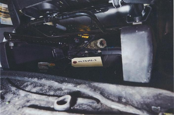 <p>The tape-wrapped bar as found under a seat in McArthur's 2017 van. (Photo provided by the Crown) </p>