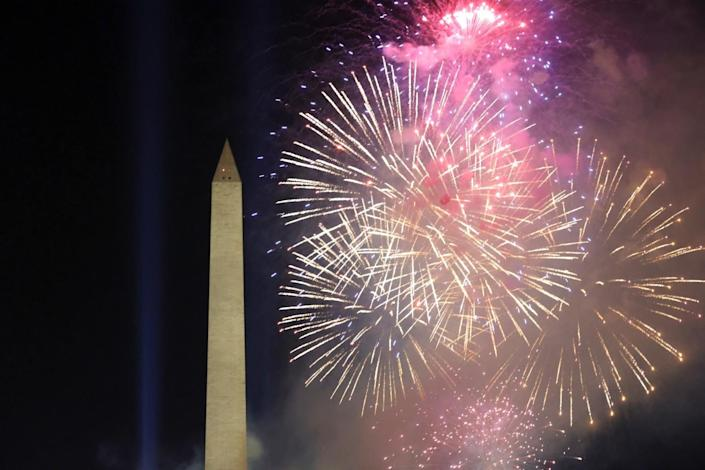 Fireworks frame the Washington Monument during an Inauguration Day event at the Lincoln Memorial.