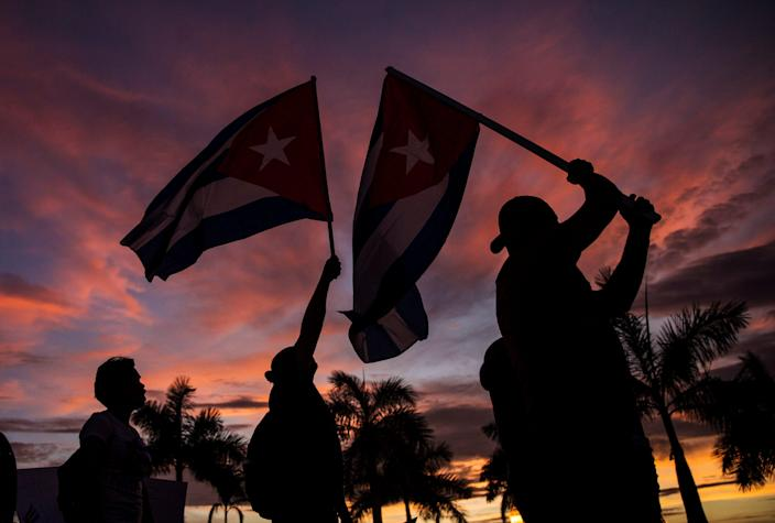 Cuban flags are raised and waved in downtown Fort Myers on Tuesday, July 13, 2021 as part of a march demanding freedom for the Cuban people that are still in Cuba. The event in Fort Myers was called the Walk for Cuba. About 1,000 people attended the event.