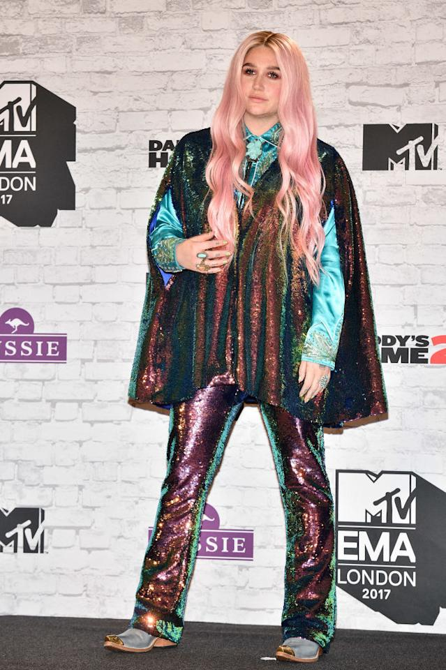 "<p>The ""Rainbow"" artist appropriately wore a ROYGBV suit topped off with a colorful cape. (Photo: Getty Images) </p>"