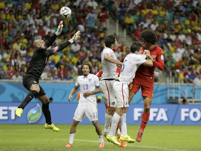 United States' goalkeeper Tim Howard leaps up to stop a header by Belgium's Marouane Fellaini during the World Cup round of 16 soccer match between Belgium and the USA at the Arena Fonte Nova in Salvador, Brazil, Tuesday, July 1, 2014. (AP Photo/Natacha Pisarenko)