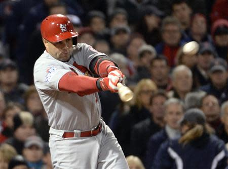 St. Louis Cardinals right fielder Carlos Beltran hits a RBI single against the Boston Red Sox in the 7th inning during game two of the MLB baseball World Series at Fenway Park. Mandatory Credit: Robert Deutsch-USA TODAY Sports
