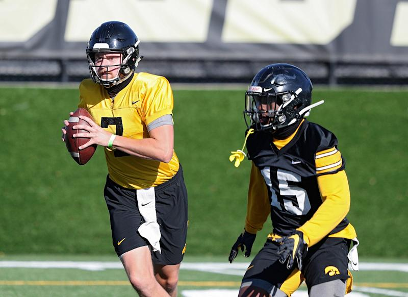 Iowa's new starting quarterback, Spencer Petras, looks to pass during Monday's practice session. Running back Tyler Goodson is to his left. Petras only attempted 10 passes a year ago, but expectations are high that the redshirt sophomore can ignite a potent Hawkeye offense.