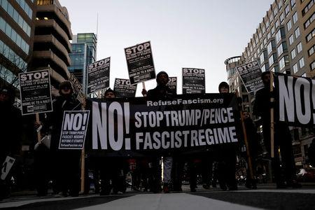 Anti-Trump demonstrators organized by RefuseFascism.org march through the streets of Washington January 18, 2017. REUTERS/James Lawler Duggan