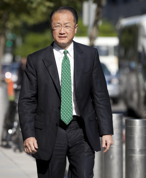 Dr. Jim Yong Kim arrives for his first day as president of the World Bank Group, Monday, July 2, 2012, in Washington. (AP Photo/Evan Vucci
