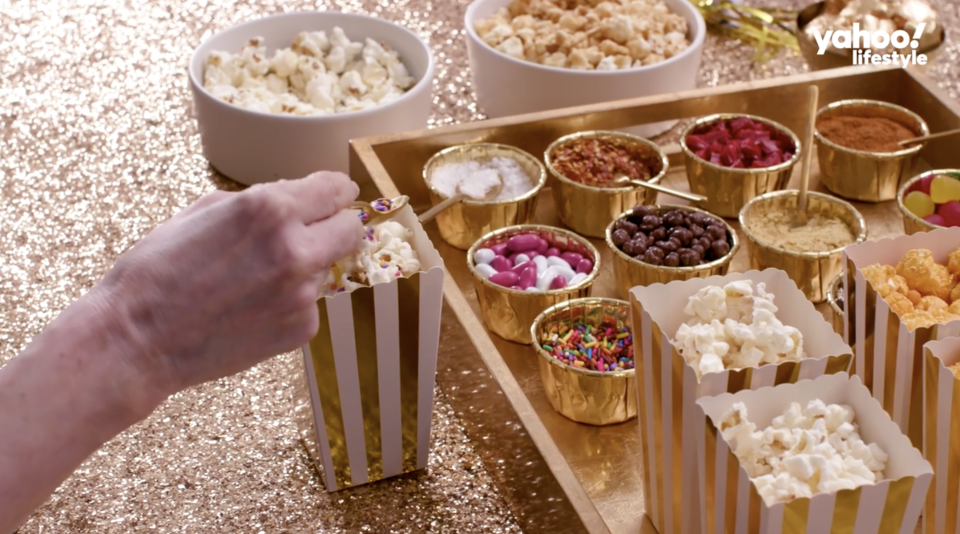A DIY popcorn bar should be a must-have for any party, not just for the Oscars. (Photo: Yahoo Lifestyle)